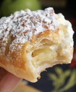 Handheld apple turnover with cream