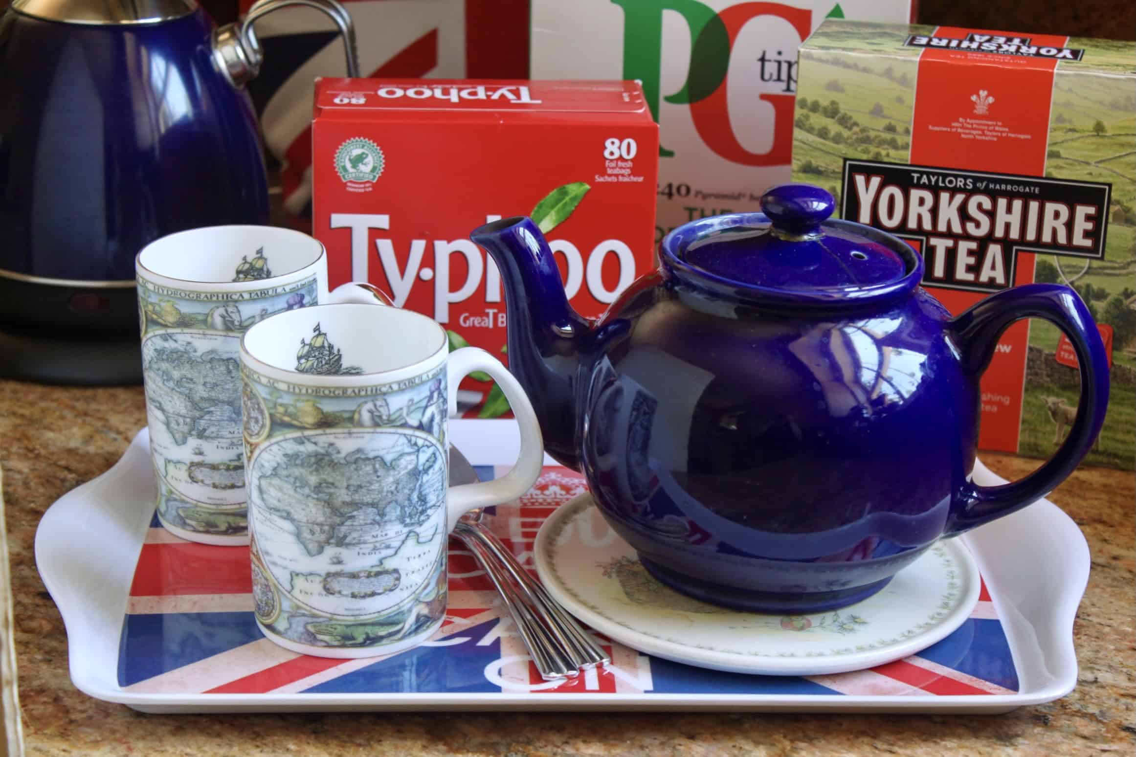 how to make a cup of British tea showing teapot, mugs and tea