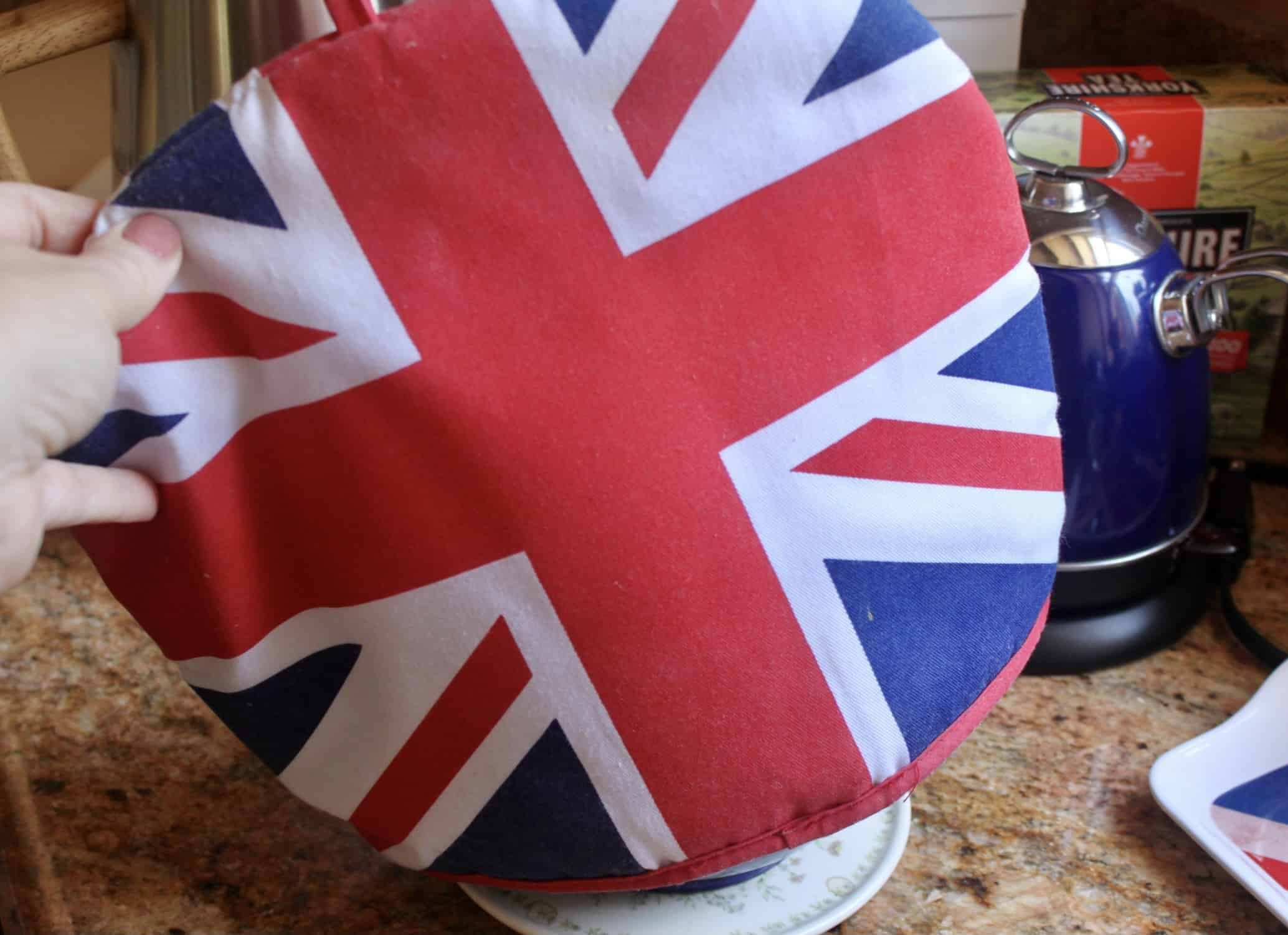 putting Union Jack tea cosy on teapot