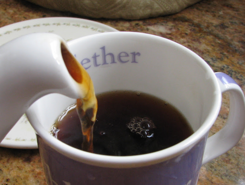 pouring British tea into a mug