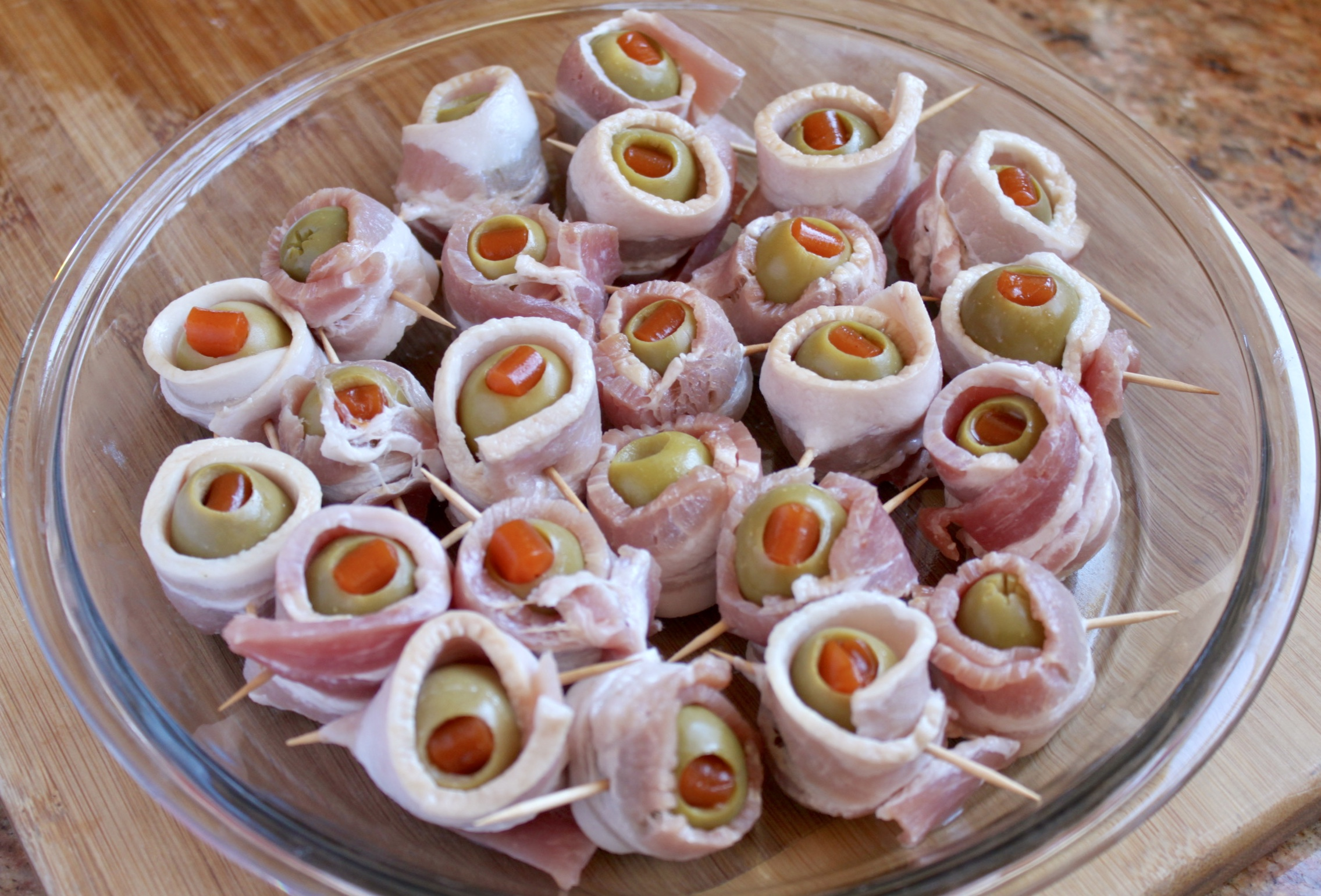 bacon wrapped olives ready to bake