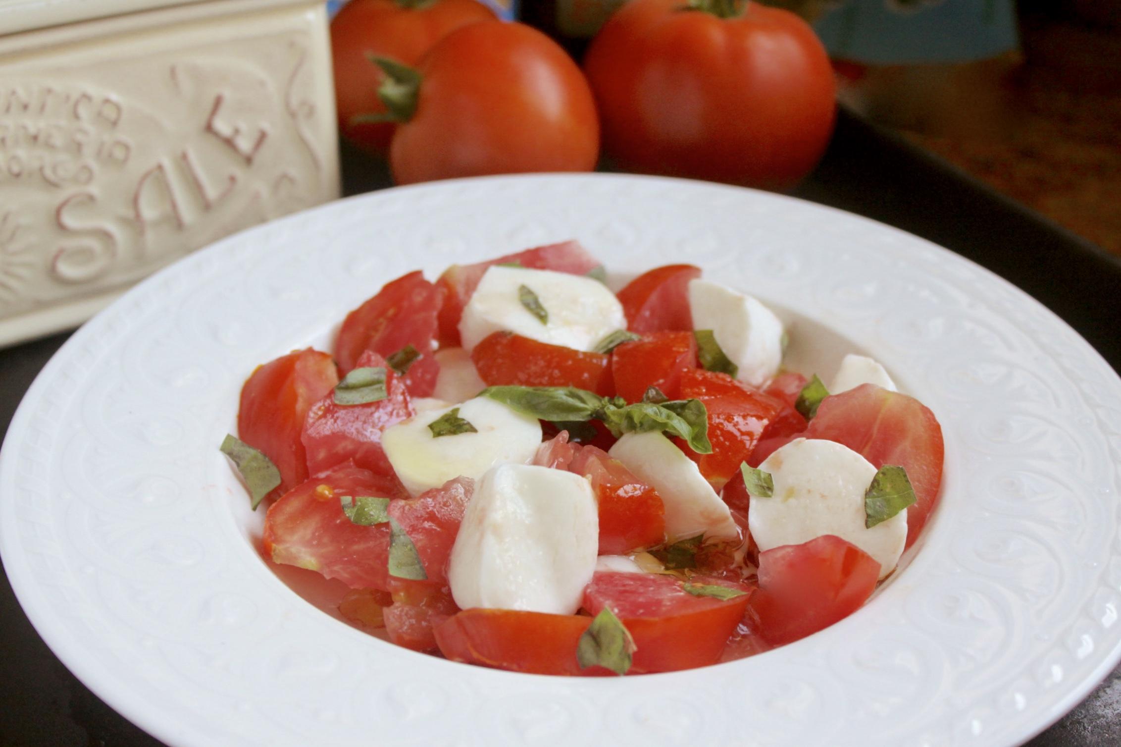 making mozzarella and tomato caprese salad