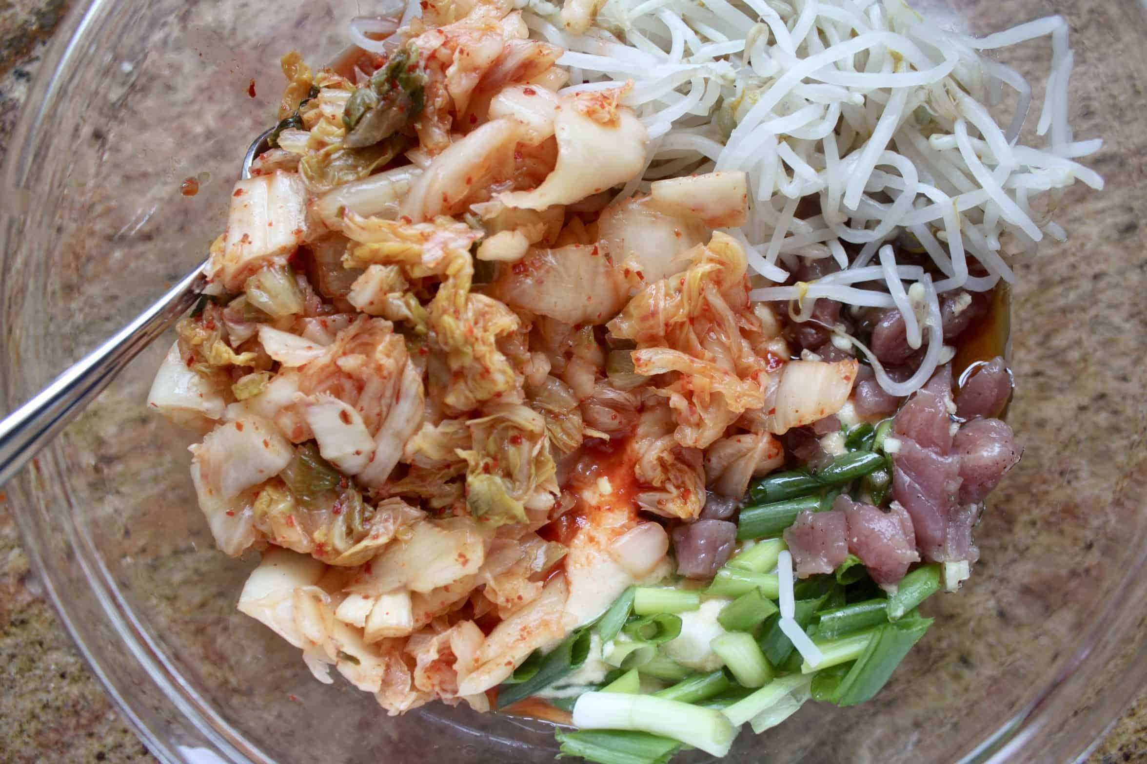 all ingredients in bowl for mung bean pancakes