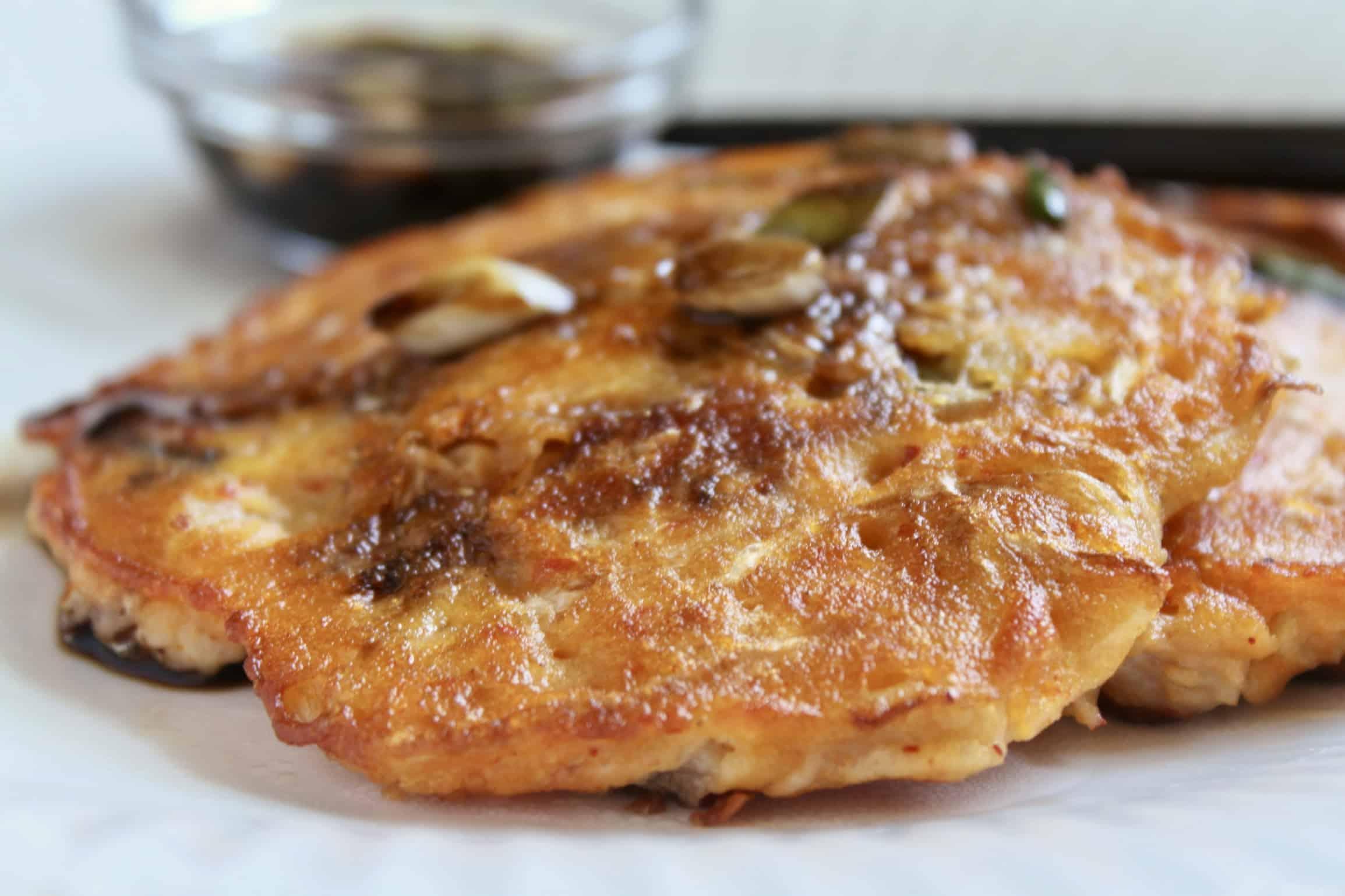 mung bean pancakes on a plate with chopsticks