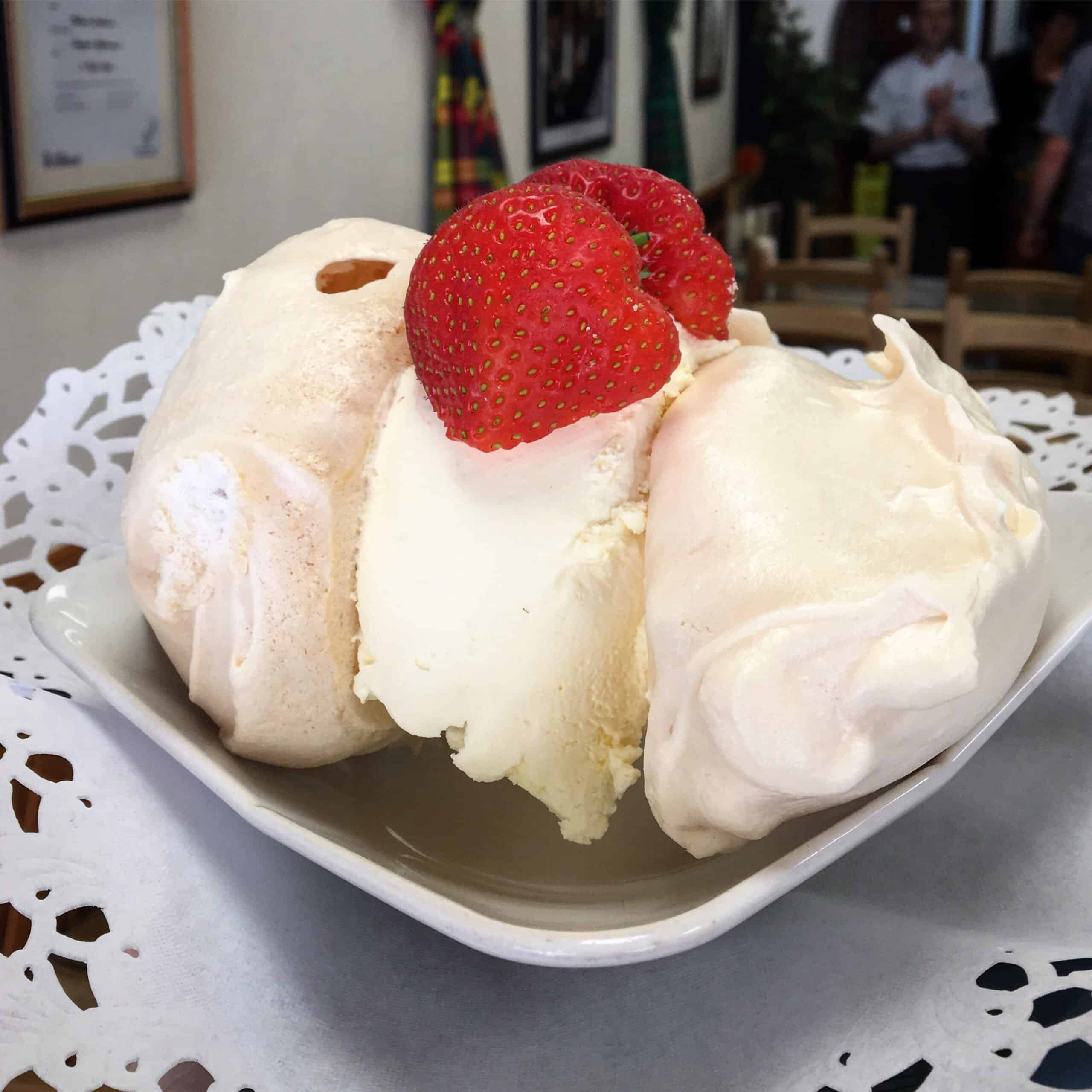 meringues sandwiched together with thick cream
