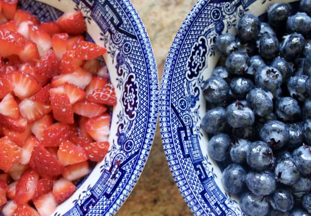 strawberries and blueberries in bowls