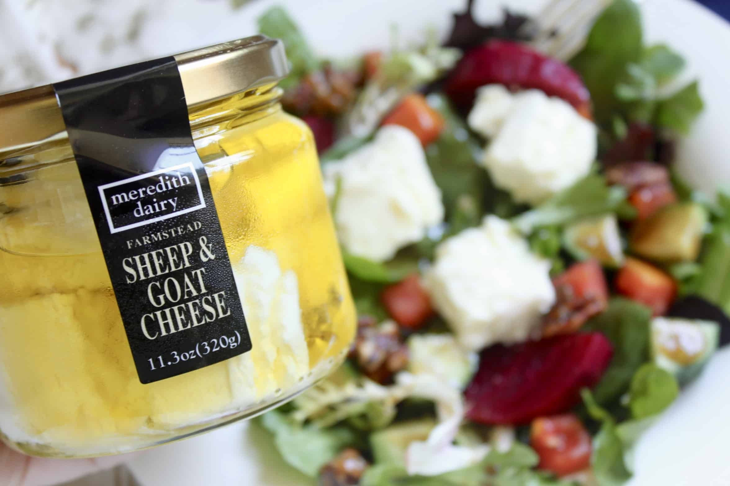 Meredith Dairy goat cheese in a jar with a salad