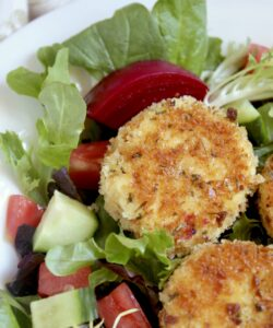 breaded goat cheese and beets on a salad