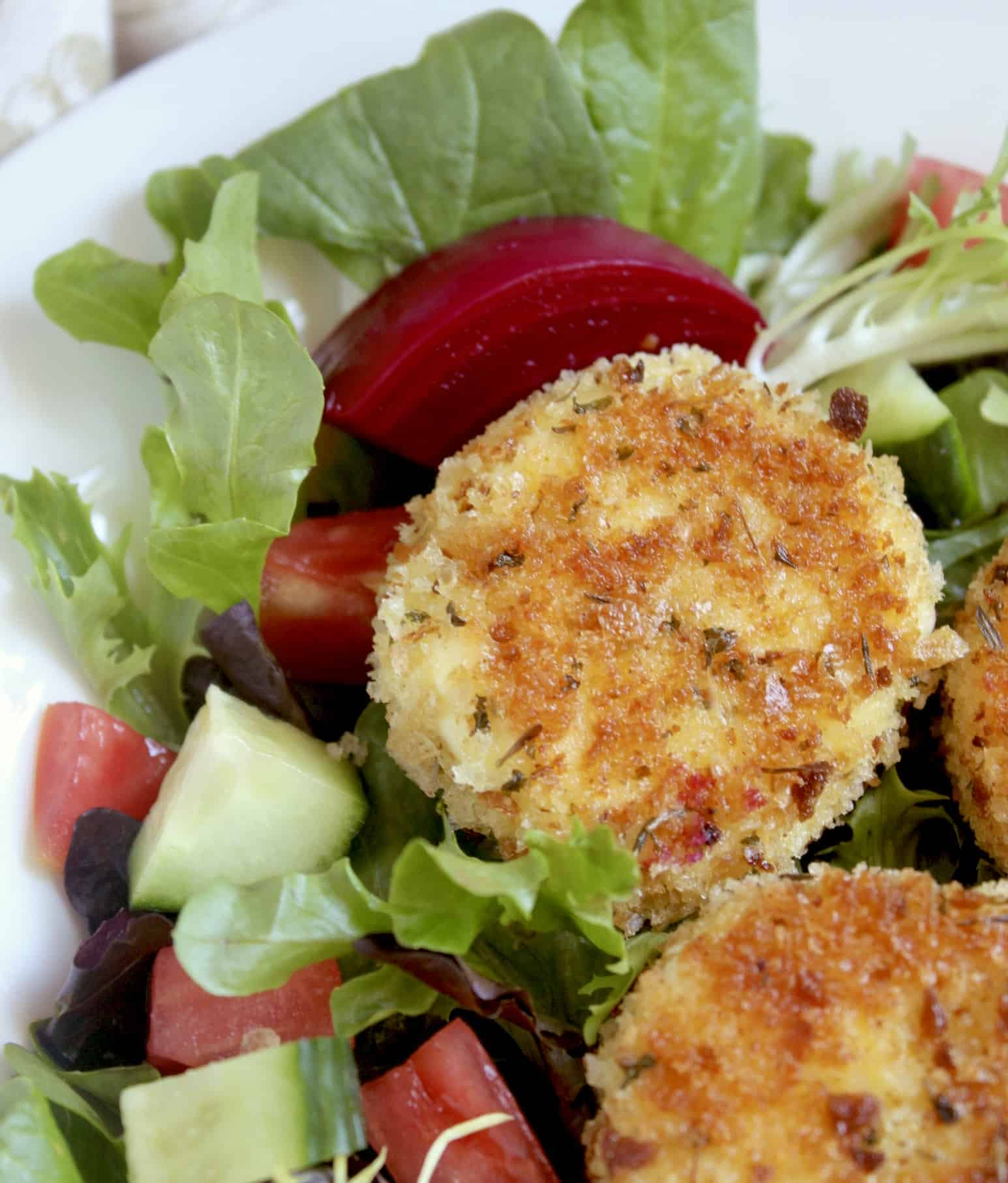 salad with vegetables and breaded cheese rounds