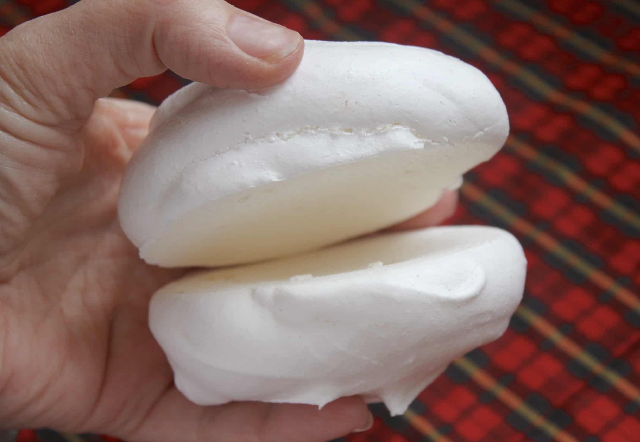 holding two meringues