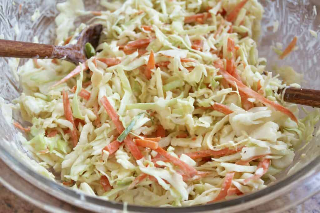 making spicy cole slaw in a bowl