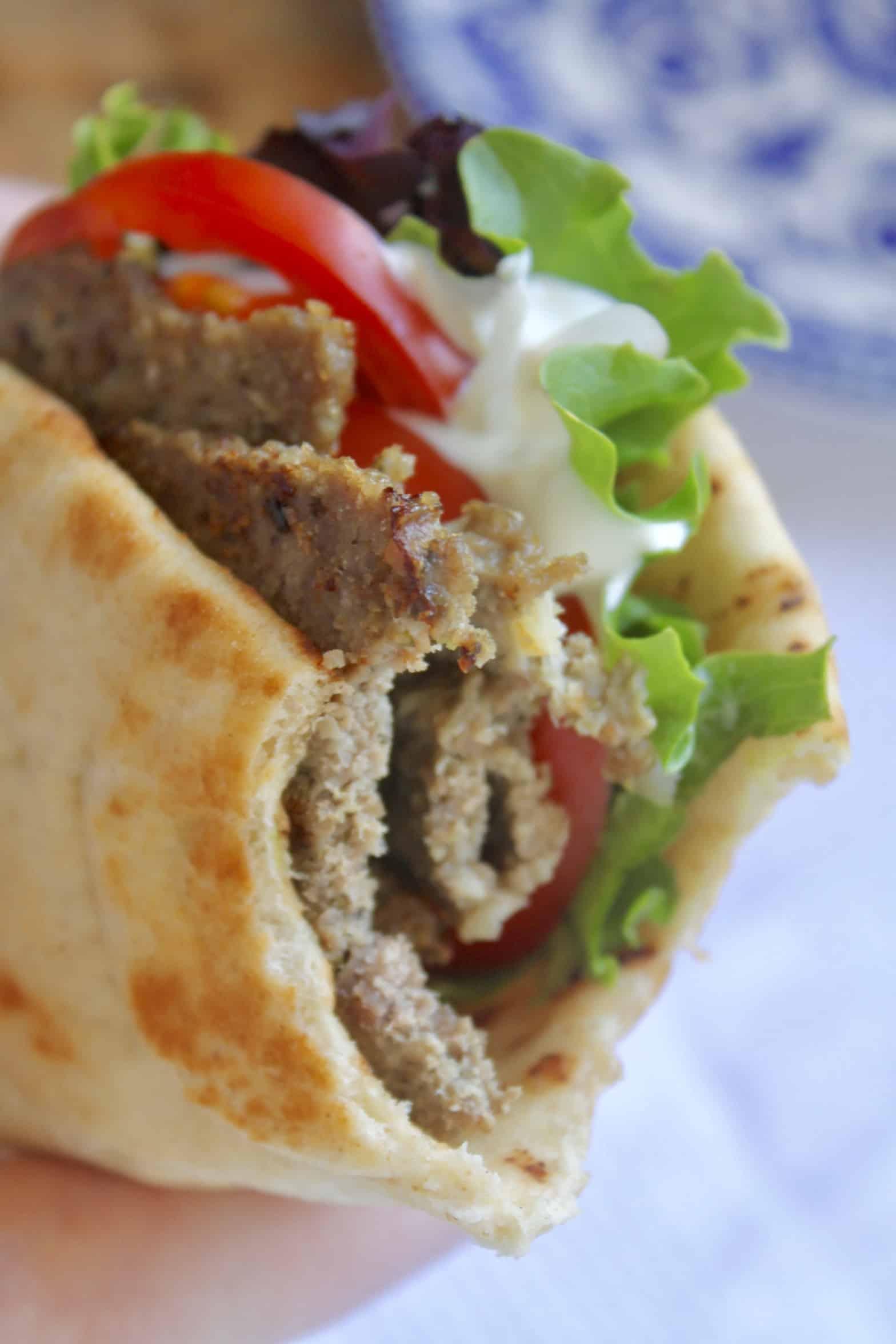 close up of a bitten gyro sandwich