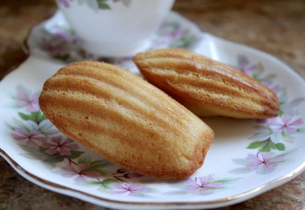 madeleines on a saucer with tea