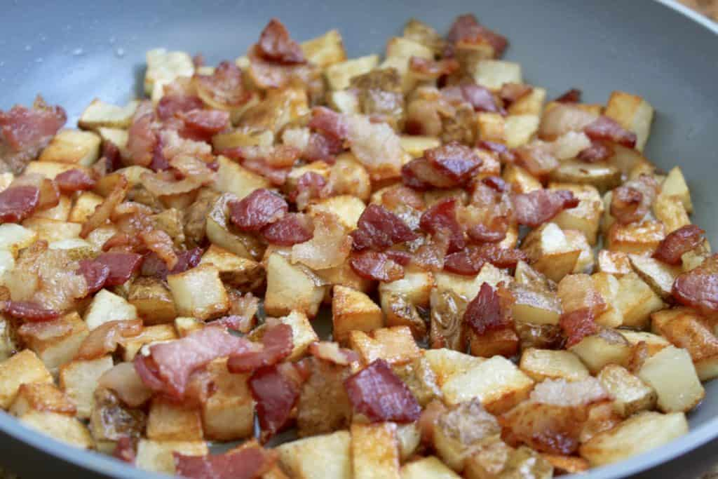 Bacon and potatoes ready for eggs in frittata