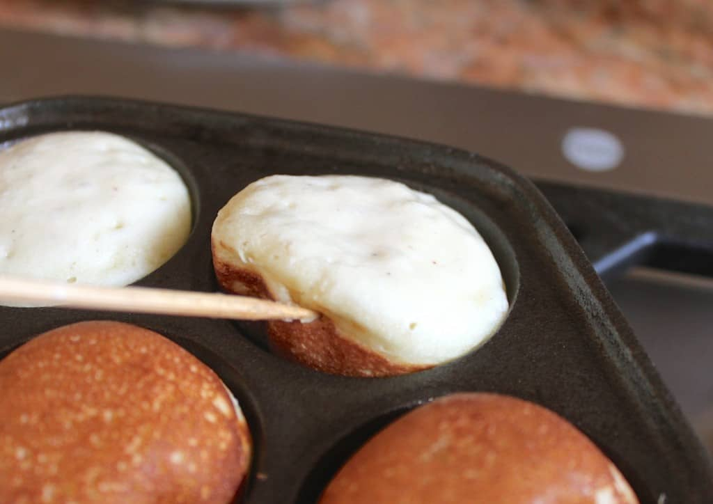 turning aebleskiver in pan