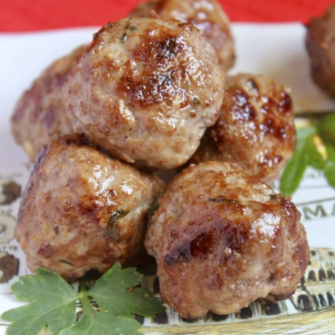 plate with meatballs and parsley on it
