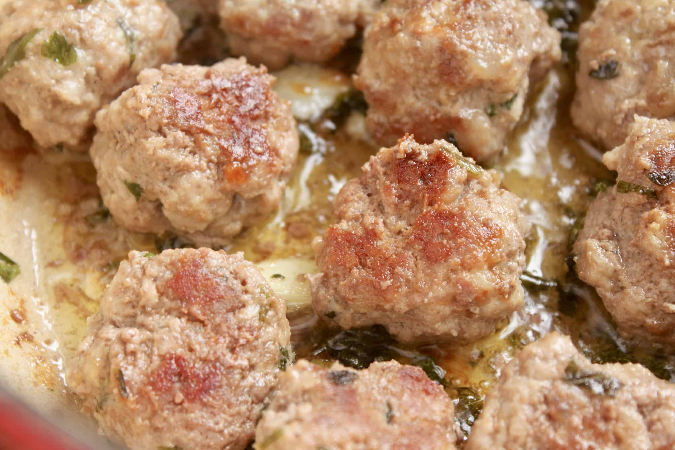 cooking meatballs in a pot