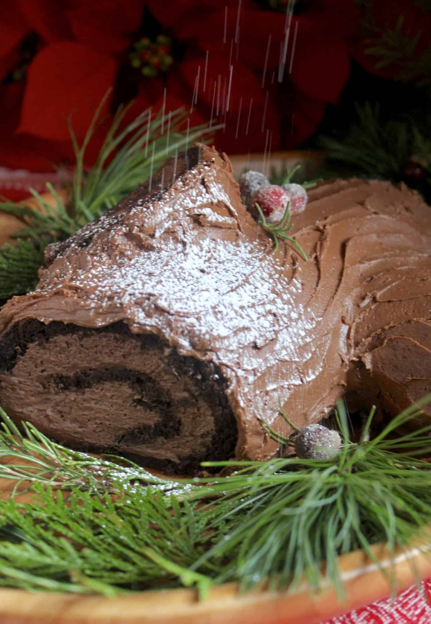 dusting sugar on yule log