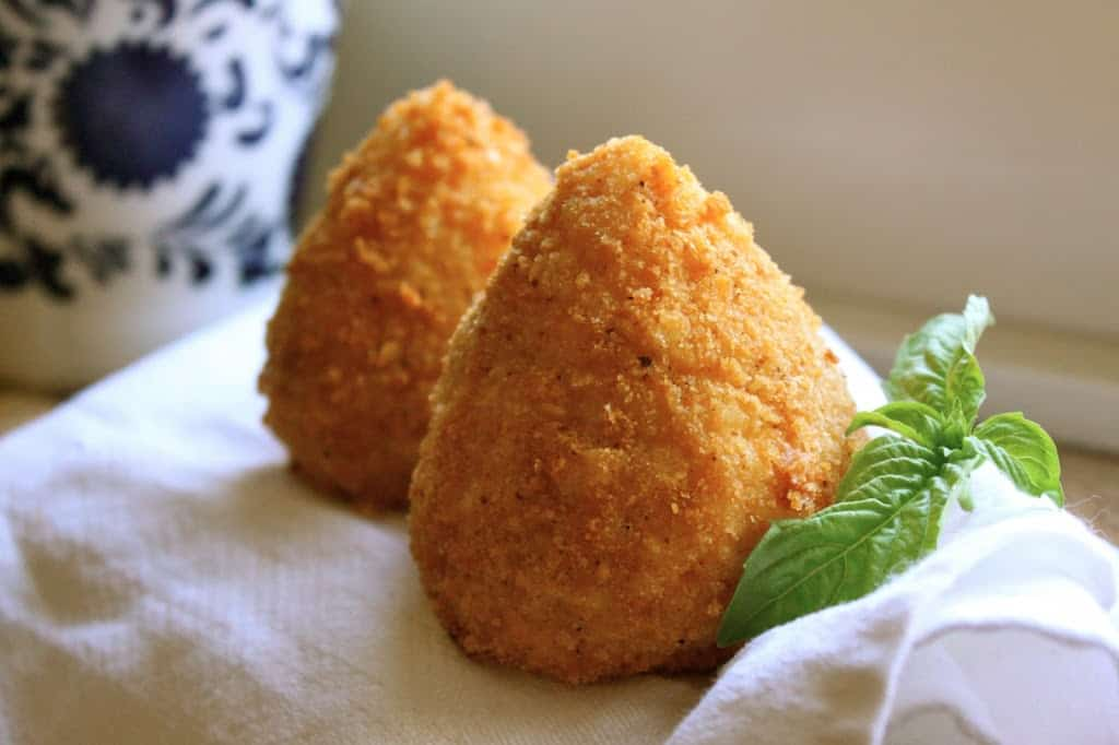 Rich and Creamy Saffron Arancini With Mozzarella Recipe | Serious Eats