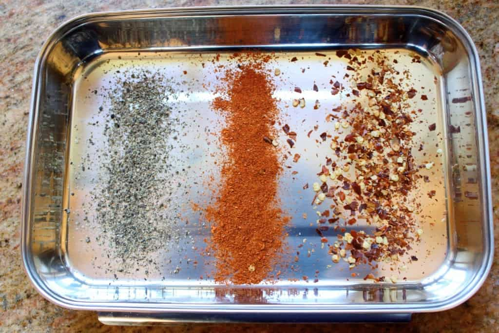 three types of pepper in a tray