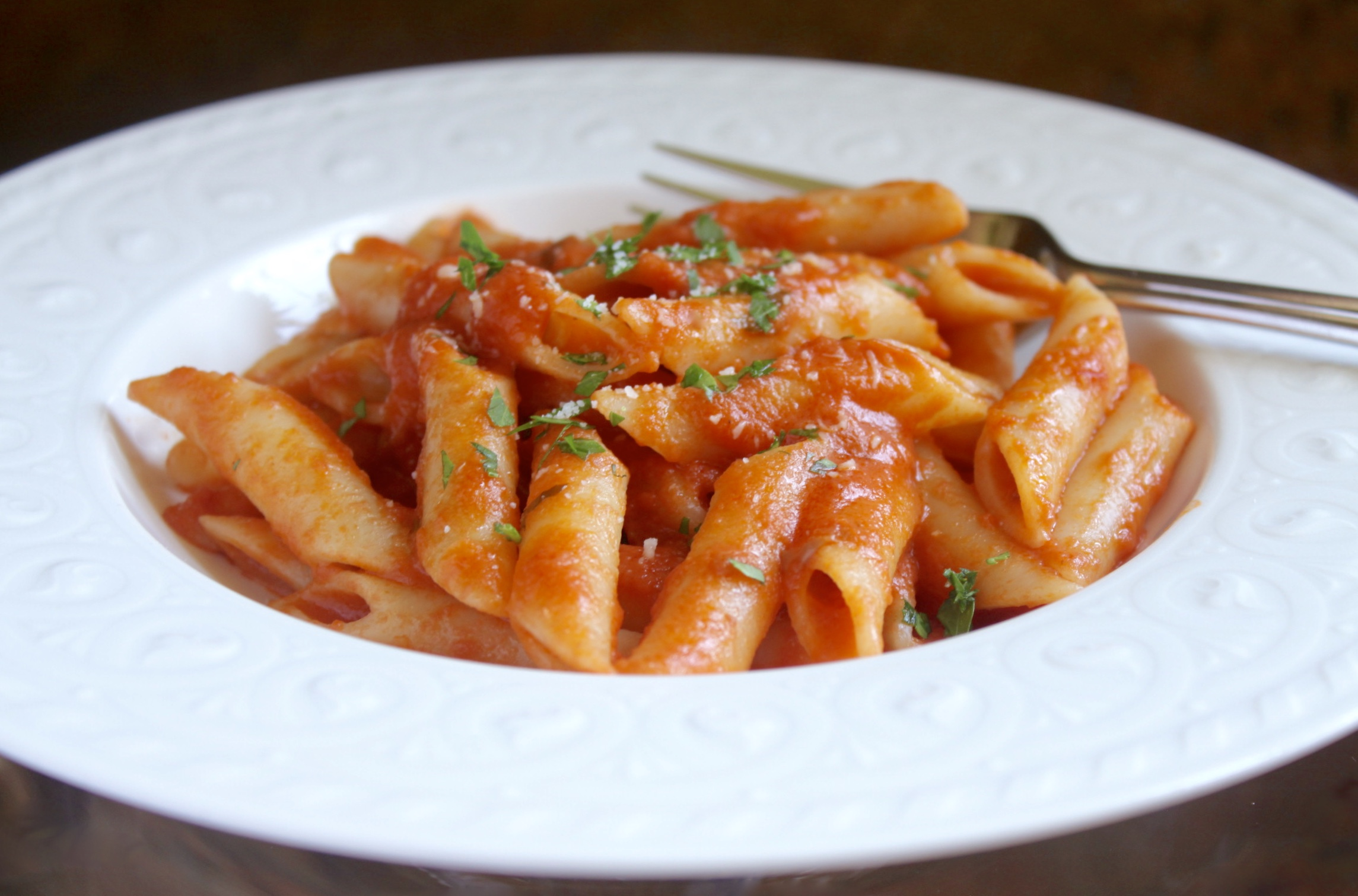 penne alla vodka with cheese and parsley