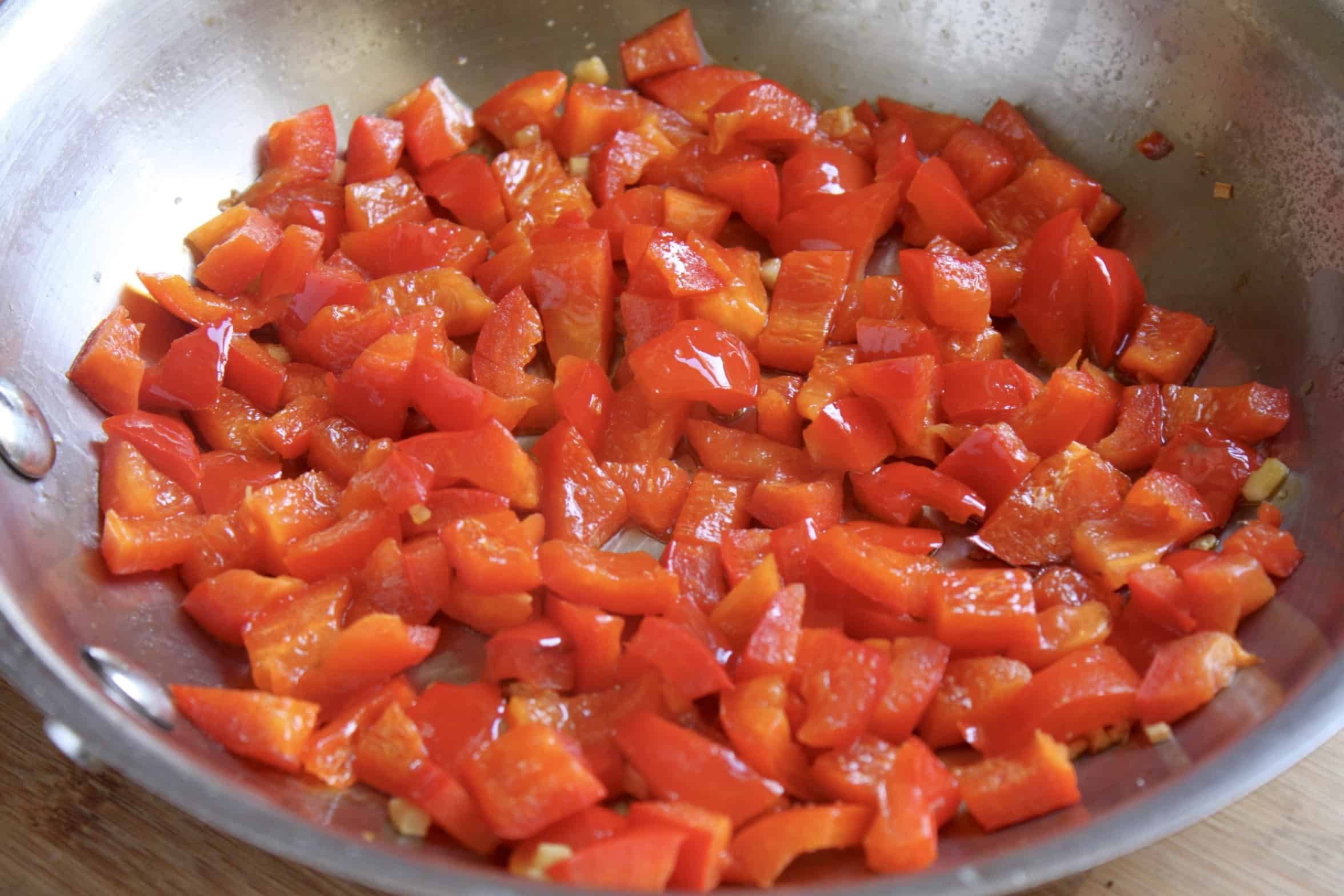 red bell peppers in a pan