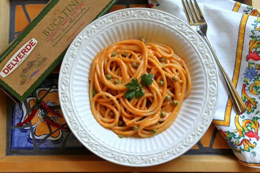 bucatini pasta red pepper peas parsley italian dish sauce recipe