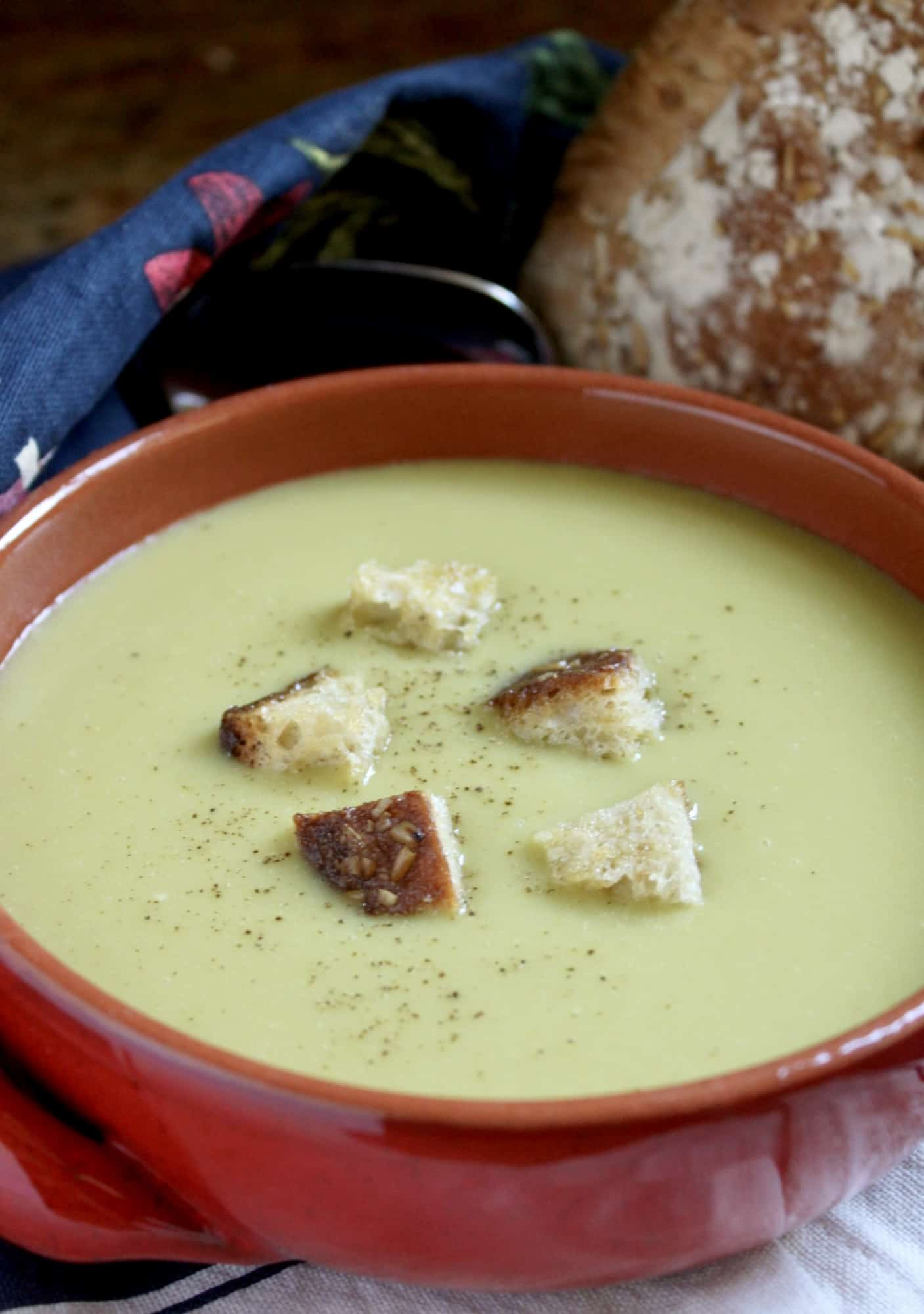 split pea soup in a red bowl