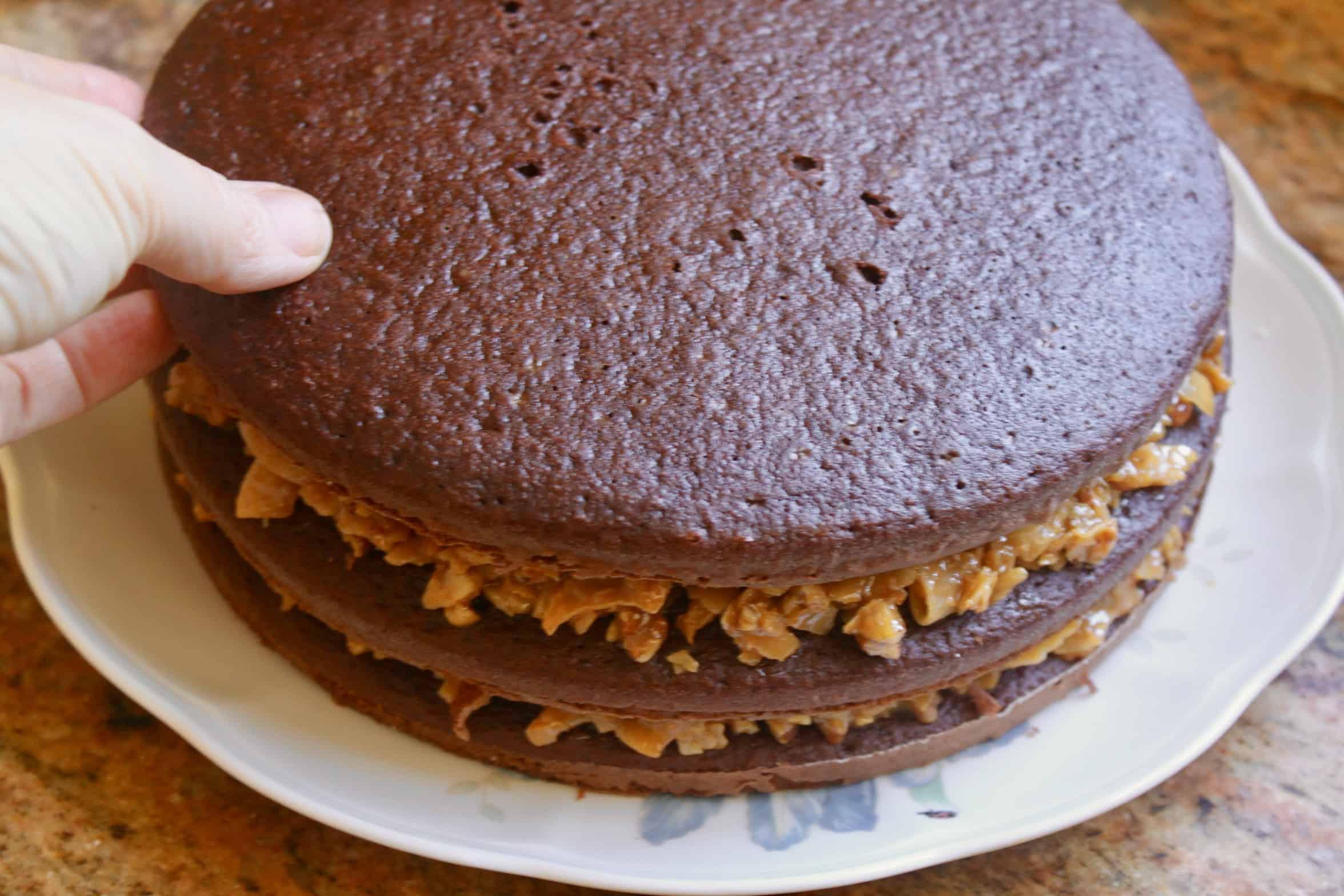 assembling German chocolate cake