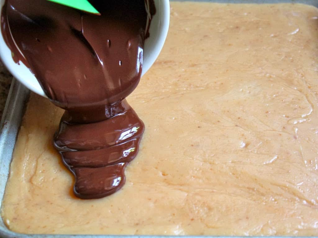 pouring chocolate onto caramel layer