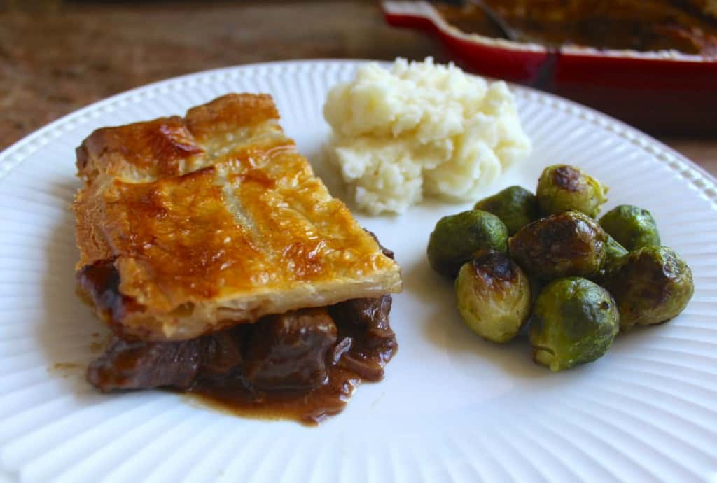Scottish Steak Pie with mashed potatoes and brussel sprouts