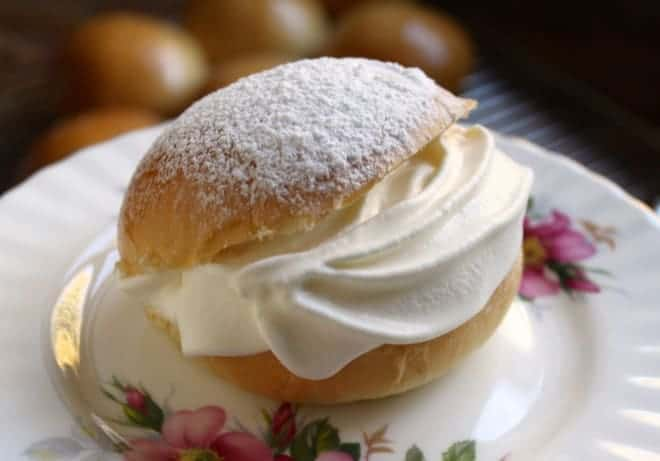 Scottish cream bun filled with cream and sprinkled with powdered sugar