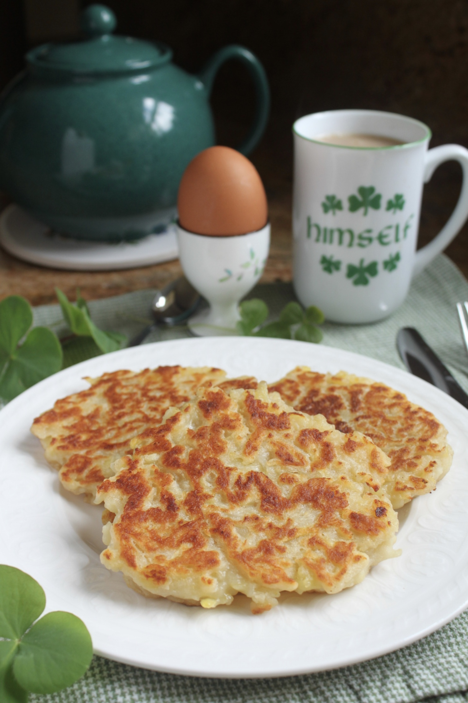 Irish boxty with cup of tea and soft boiled egg