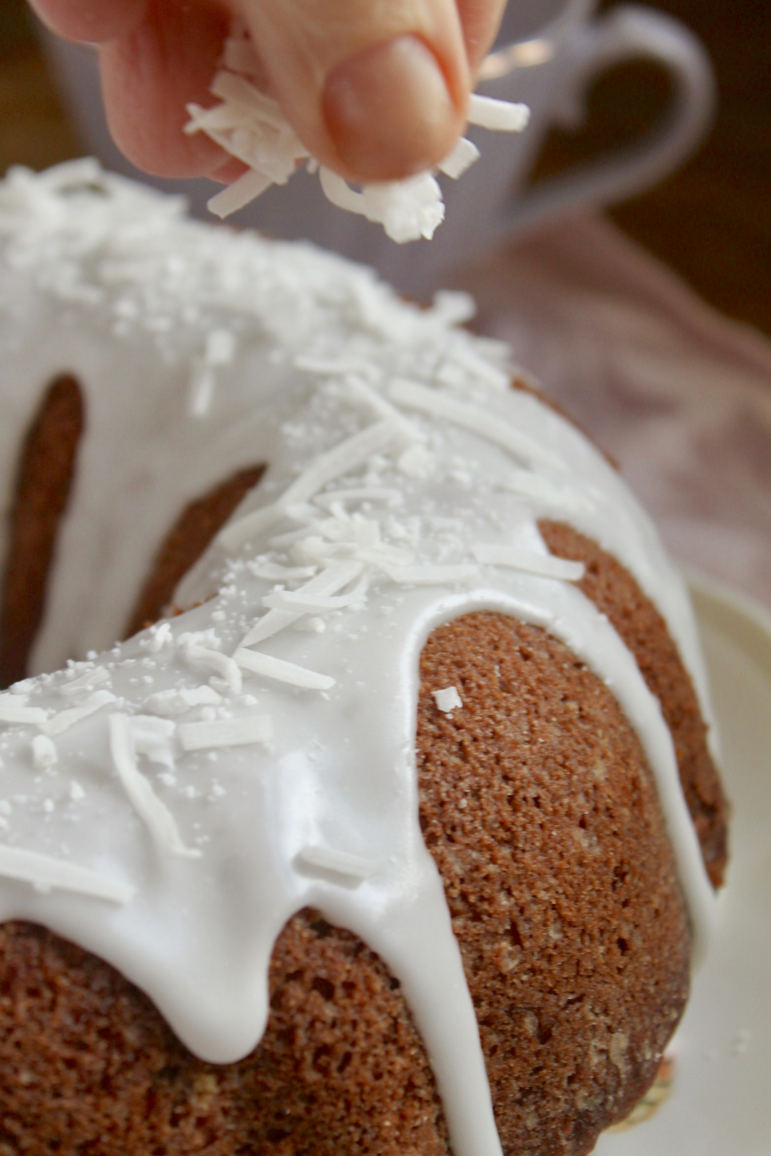 decorating banana coconut bundt cake