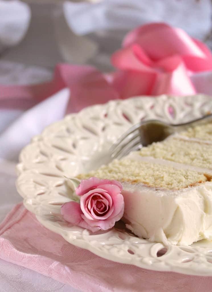 Slice of white cake with rosebud