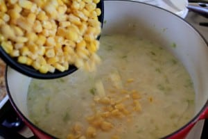 adding corn to chowder