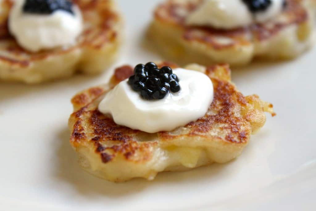 "miniature Irish Boxty appetizers with creme fraiche and truffle ""caviar"""