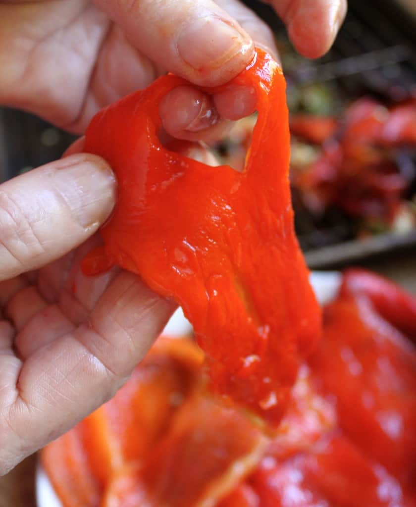 tearing roasted red peppers into strips