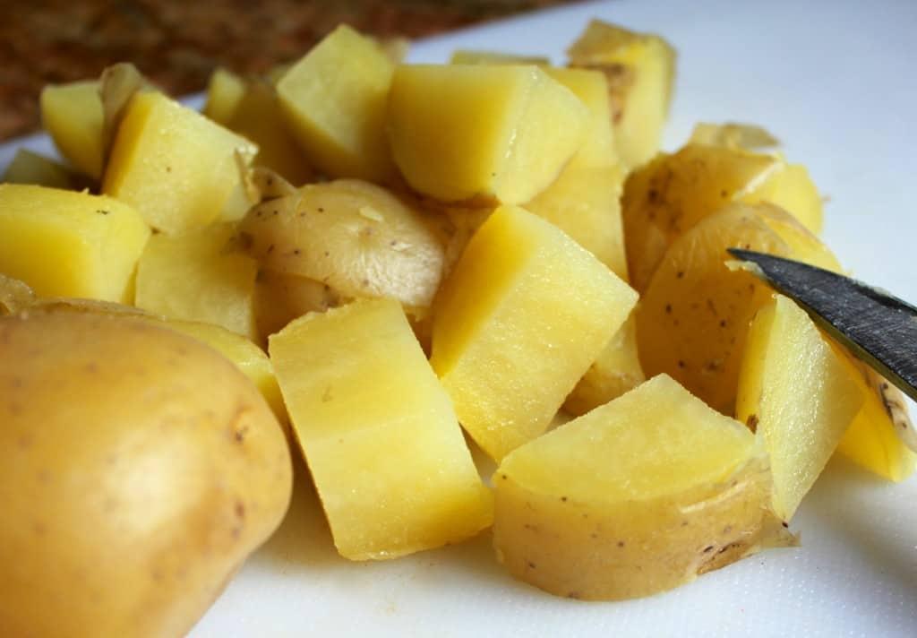 chopping yellow Idaho potatoes