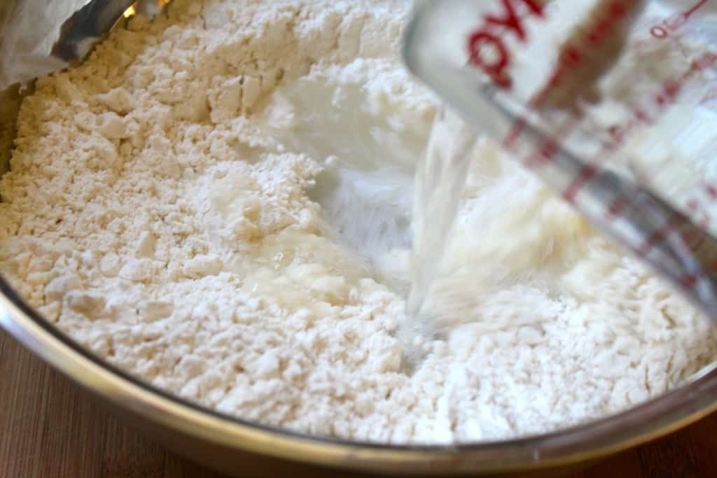 pouring-water-into-flour-for-gnocchi.jpg