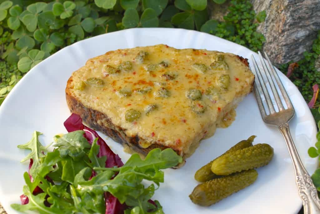 Irish Rarebit on a plate with clover behind