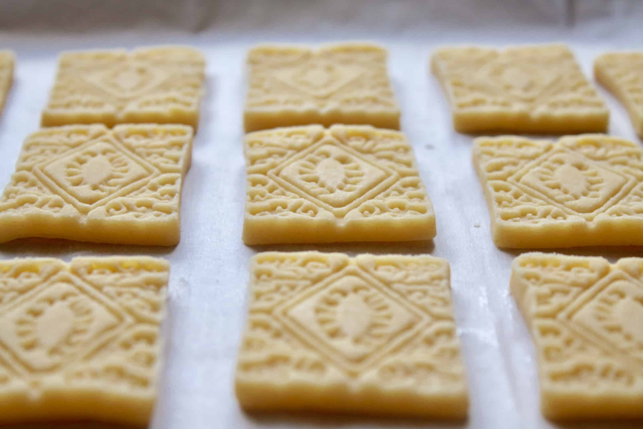 row of biscuits ready to bake