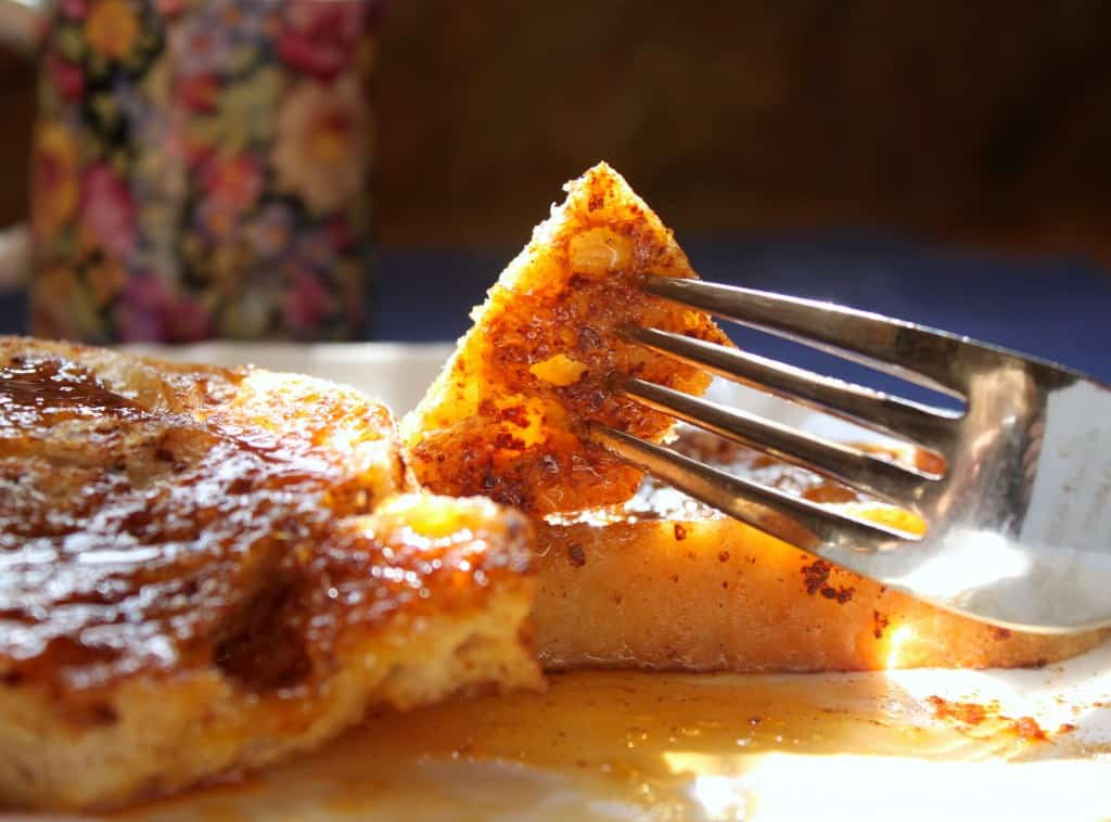 Bite of cinnamon french toast with orange sauce