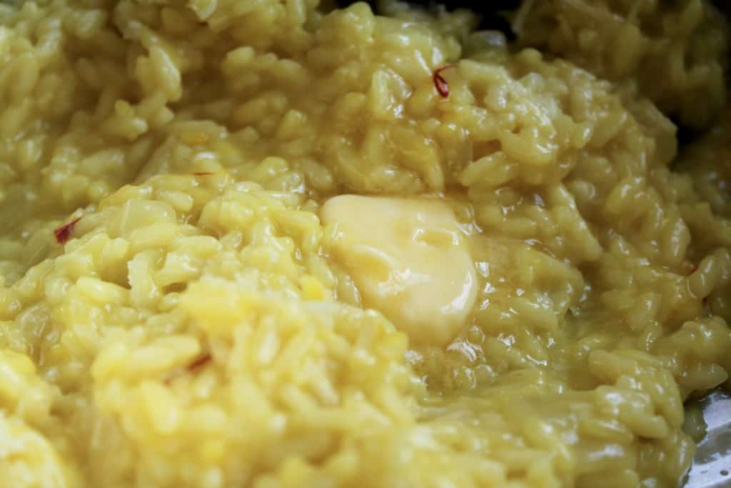 Adding butter to Risotto alla Milanese