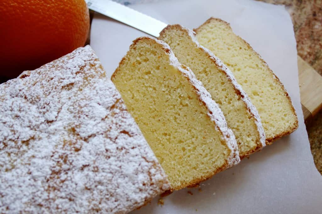 Slicing gluten-free orange loaf cake