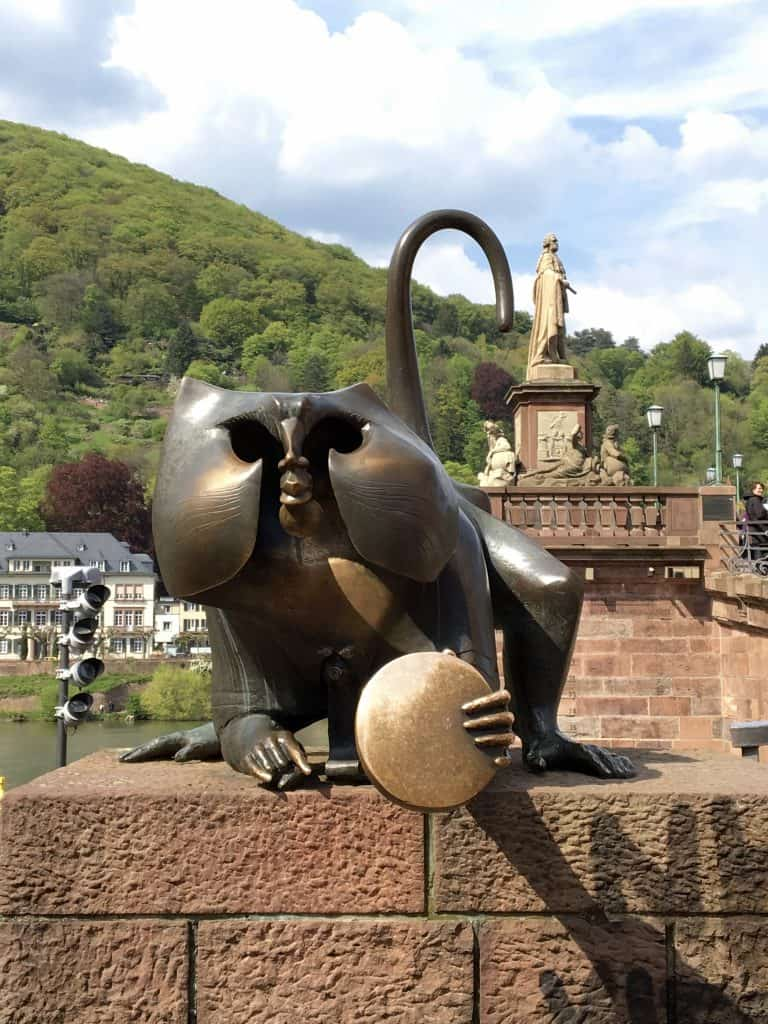 Bridge monkey in Heidelberg, holding a mirror.