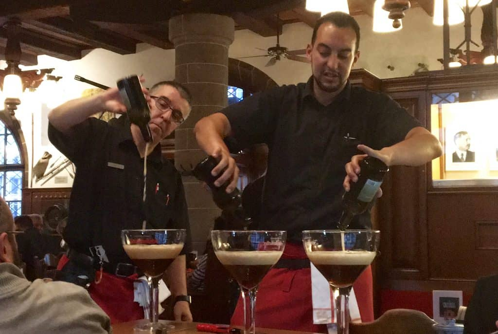 Pouring beer into the glasses.
