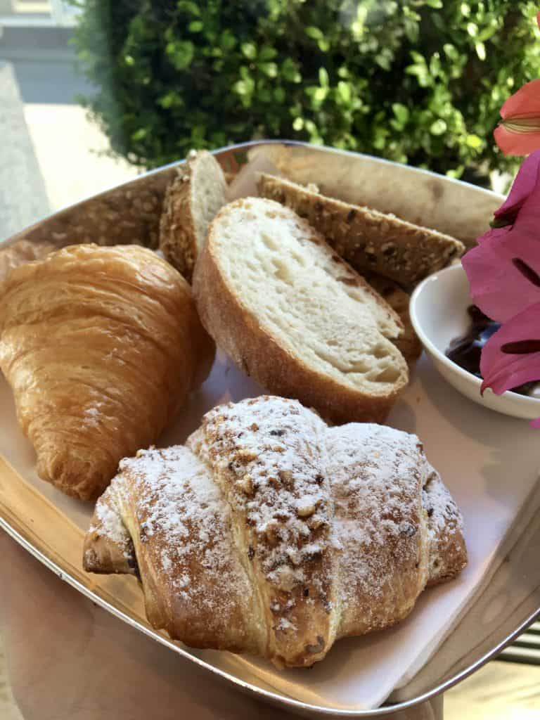 Plate of bread and pastries at Hotel Schweizerhof