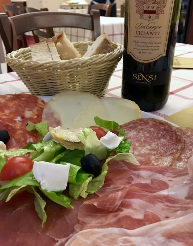 Antipasto, bread and wine in Rome.