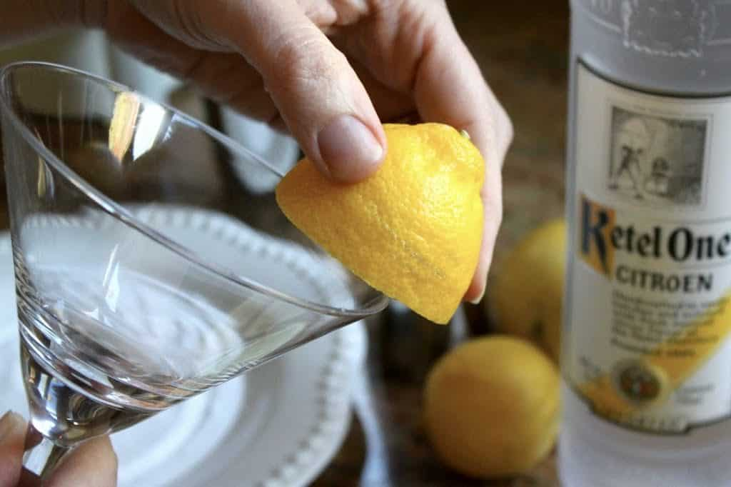 Rubbing glass with lemon to make Lemon Drop Martinis